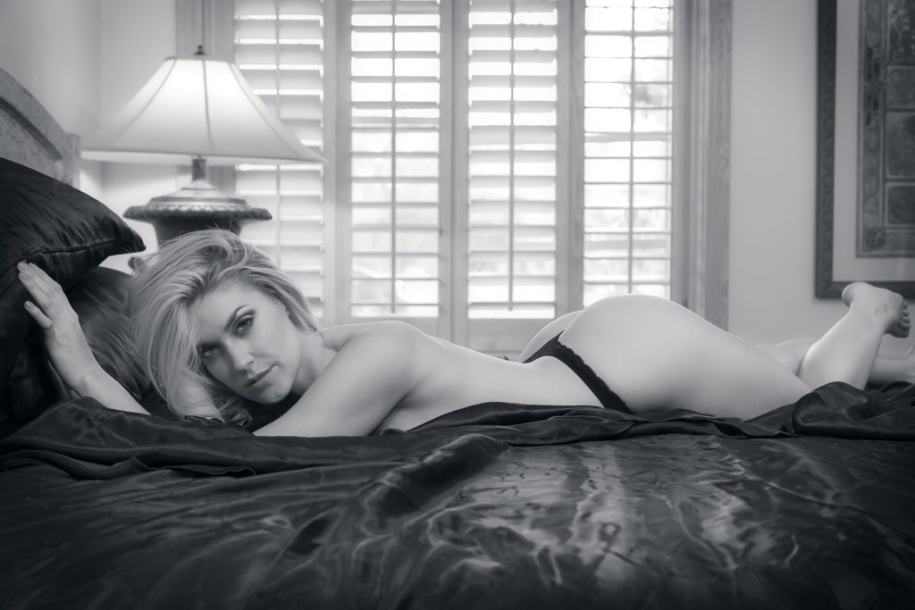 B&W image of semi naked female escort who uses Web Design For Escorts to advertise her escort services